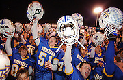 Mountain Home, Arkansas, High School football players celebrate a victory.