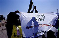 SPECIAL OLYMPICS AFGHANISTAN..Kabul, 23 August 2005..SOA's  Torch Run from Darul Aman to Ghazi Stadium...Volunteers and athlethes holding the Afghan Flag and the Special Olympics Banner.