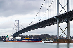 INEOS gas tanker transporting shale gas from the USA to Grangemouth refinery in Scotland ,sailing past the Forth Road Bridge on the Firth of Forth in Scotland, UK
