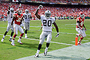 KANSAS CITY, MO - SEPTEMBER 20:   Darren McFadden #20 of the Oakland Raiders celebrates after scoring a touchdown against the Kansas City Chiefs at Arrowhead Stadium on September 20, 2009 in Kansas City, Missouri.  The Raiders defeated the Chiefs 13-10.  (Photo by Wesley Hitt/Getty Images) *** Local Caption *** Darren McFadden