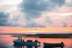 Boats against a dramatic sunset sky in Amagansett, NY