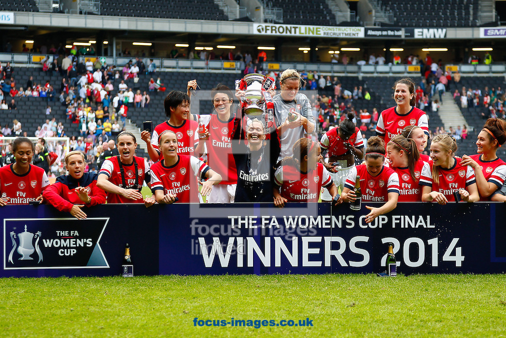 Shelley Kerr Head Coach of Arsenal L.F.C. lifts the winner's trophy aloft after the FA Women's Cup Final match at stadium:mk, Milton Keynes<br /> Picture by David Horn/Focus Images Ltd +44 7545 970036<br /> 01/06/2014