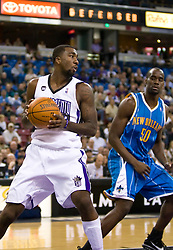 November 29, 2009; Sacramento, CA, USA;  Sacramento Kings forward Donte Greene (20) grabs a rebound in front of New Orleans Hornets center Emeka Okafor (50) during the first quarter at the ARCO Arena. Sacramento defeated New Orleans 112-96.