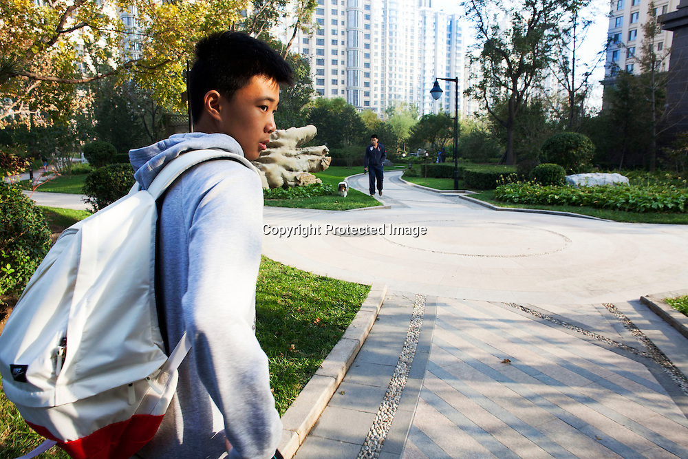 BEIJING, OCT.18, 2014 : Song Yonglin, 14, on the way to school . He spends every weekend taking extra school lessons in order to improve his scores which cost his parents about 4-5000 Yuan/month. He would like to switch to the International school in Beijing  and study economics later on in the US.