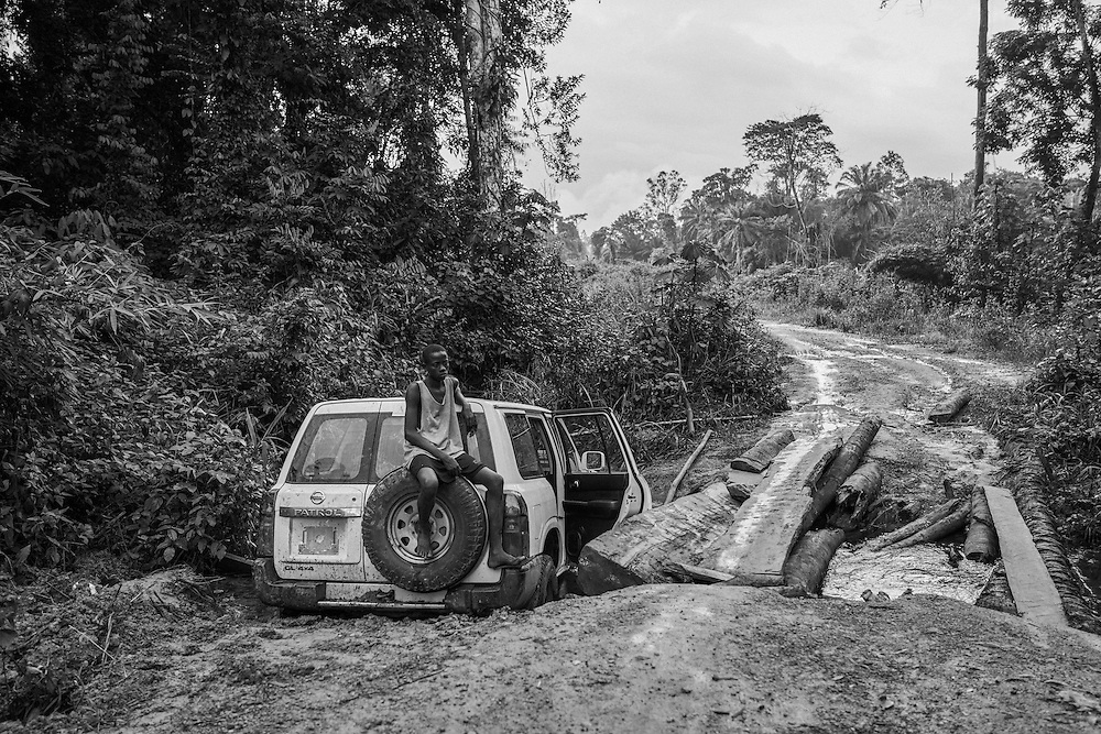 Americares, one of the few NGOs still working in John Logan Town, after the Ebola was declared over, has their vehicle stuck enroute to the remote village.