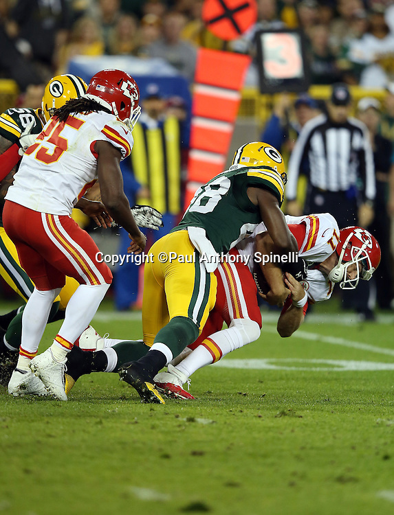 Kansas City Chiefs quarterback Alex Smith (11) gets sacked by Green Bay Packers linebacker Joe Thomas (48) in the first quarter during the 2015 NFL week 3 regular season football game against the Green Bay Packers on Monday, Sept. 28, 2015 in Green Bay, Wis. The Packers won the game 38-28. (©Paul Anthony Spinelli)