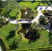 Aerial view Landscape lawn with pond and bridge in Southwest Ranches, Fl