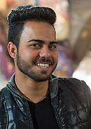 Iran, Tehran Province, Tehran, young man with western haircut in the bazaar.