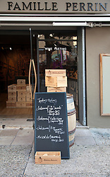 Wine tasting shops similar to Famille Perrin line the narrow streets of Chateauneuf-du-Pape. This Cotes des Rhone wine village is a must stop for tipplers touring Provence.  Its rocky soil has produced outstanding red wines for nearly 1000 years.