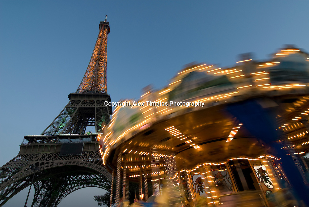 The Eiffel Tower and a carousel in Paris, France