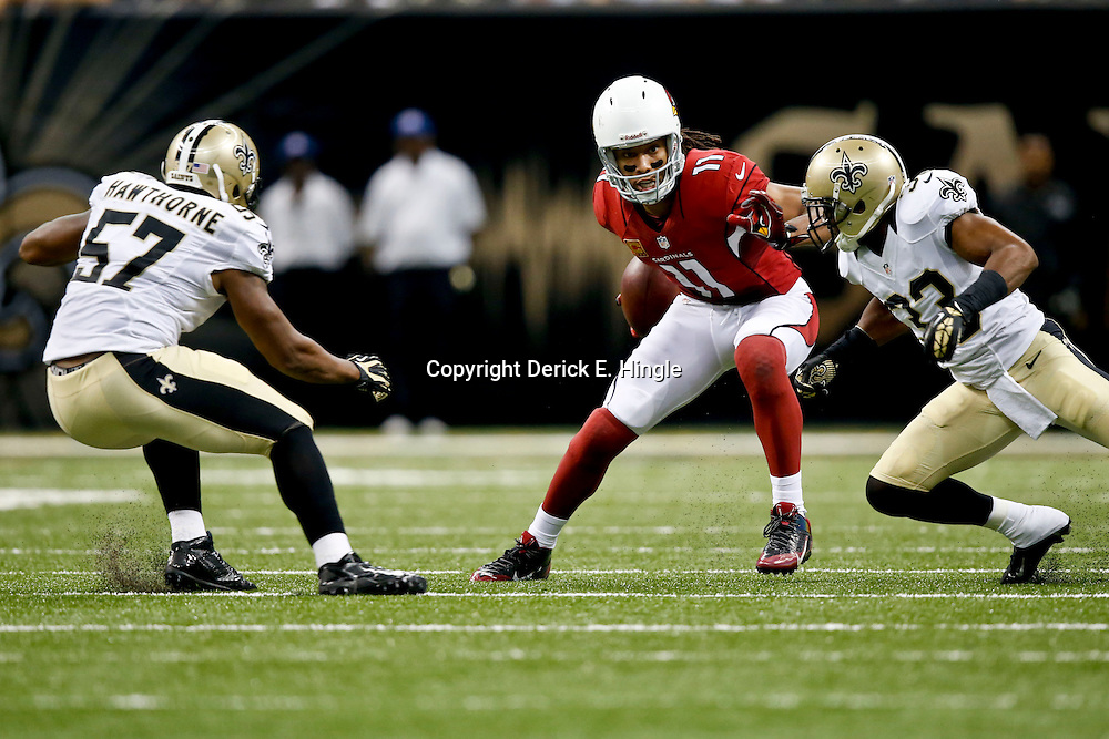 Sep 22, 2013; New Orleans, LA, USA; Arizona Cardinals wide receiver Larry Fitzgerald (11) is pursued by New Orleans Saints cornerback Jabari Greer (33) and New Orleans Saints outside linebacker David Hawthorne (57) during a game at Mercedes-Benz Superdome. The Saints defeated the Cardinals 31-7. Mandatory Credit: Derick E. Hingle-USA TODAY Sports