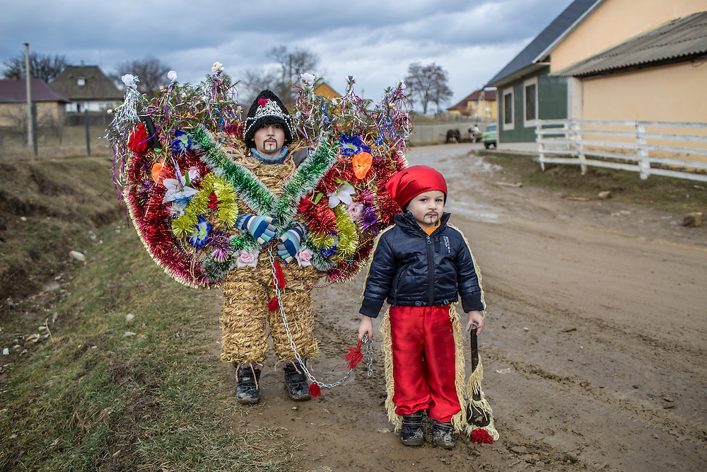 Valentyn Voloshchuk, 5, and his brother Oleksandr Voloshchuk, 2, dressed as a bear and a gypsy respectively, traditional costumes of the Malanka Festival, pose for a portrait on Wednesday, January 13, 2016 in Krasnoilsk, Ukraine. The festival will begin at sundown and last until the following evening.