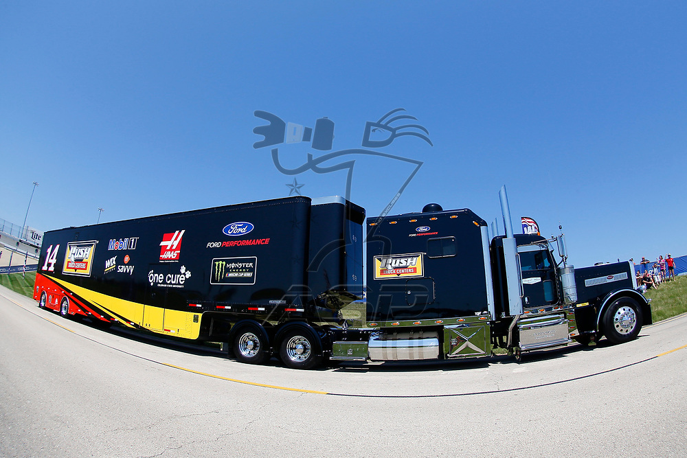 The hauler for Clint Bowyer (14) drives through the infield during hauler parking for the Overton's 400 at Chicagoland Speedway in Joliet, Illinois .