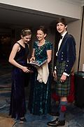 HELENA BARTON; LADY EMMA MAHMOOD, ZAIN MAHMOOD, The 171 st Royal Caledonian Ball 2019, Grovenor House, Park Lane, London. 3 May 2019