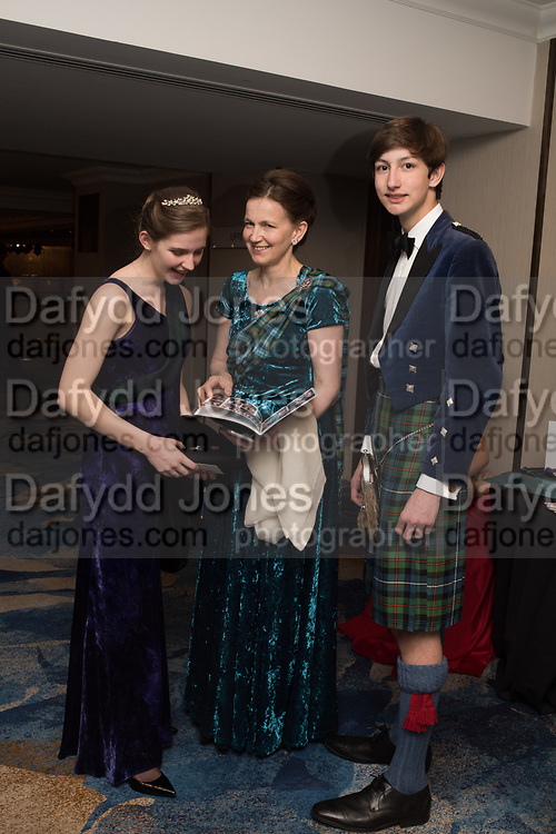 HELENA BARTON; LADY EMMA MAHMOOD, ZAIN MAHMOOD, The 171 st Royal Caledonian Ball 2019, Grovenor House, Park Lane, London. 3 May 2019