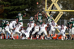 10 November 2007: The Titan defense goes up to try and block the point after being kicked by Tim Ellingsen. This game between the Wheaton College Thunder and the Illinois Wesleyan University Titans was for a share of the CCIW Championship and was played at Wilder Field on the campus of Illinois Wesleyan University in Bloomington Illinois.