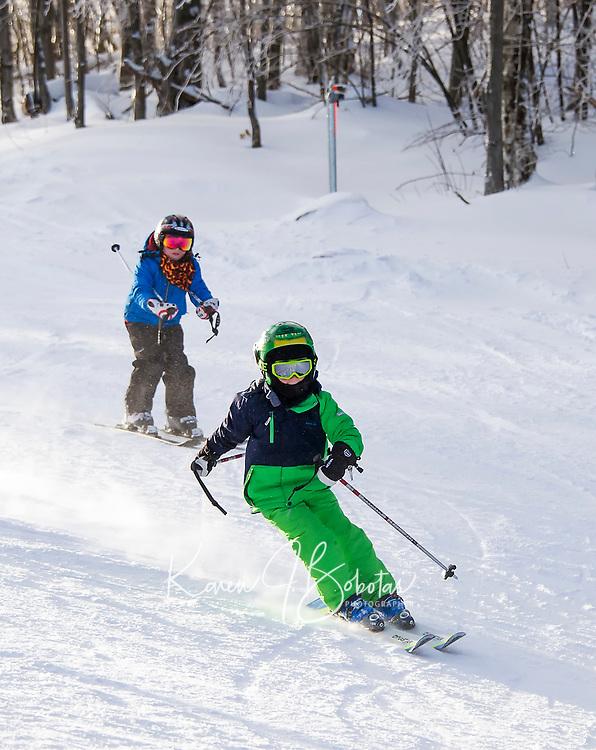 Xavier Corbin working on his turns as he skis the Newfound Ridge Trail at Ragged Mountain Tuesday morning.  (Karen Bobotas/for the Laconia Daily Sun)
