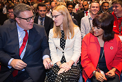 © Licensed to London News Pictures . 28/09/2016 . Liverpool , UK . TOM WATSON offers Love Heart sweets to CAT SMITH and Jeremy Corbyn's wife LAURA ALVAREZ ahead of the Leader's Speech at the close of the final day of the Labour Party Conference at the ACC in Liverpool . Photo credit : Joel Goodman/LNP