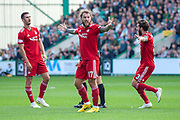 Stevie May (#17) of Aberdeen FC and the Aberdeen players appeal for a penalty during the Ladbrokes Scottish Premiership match between Hibernian and Aberdeen at Easter Road, Edinburgh, Scotland on 25 August 2018.