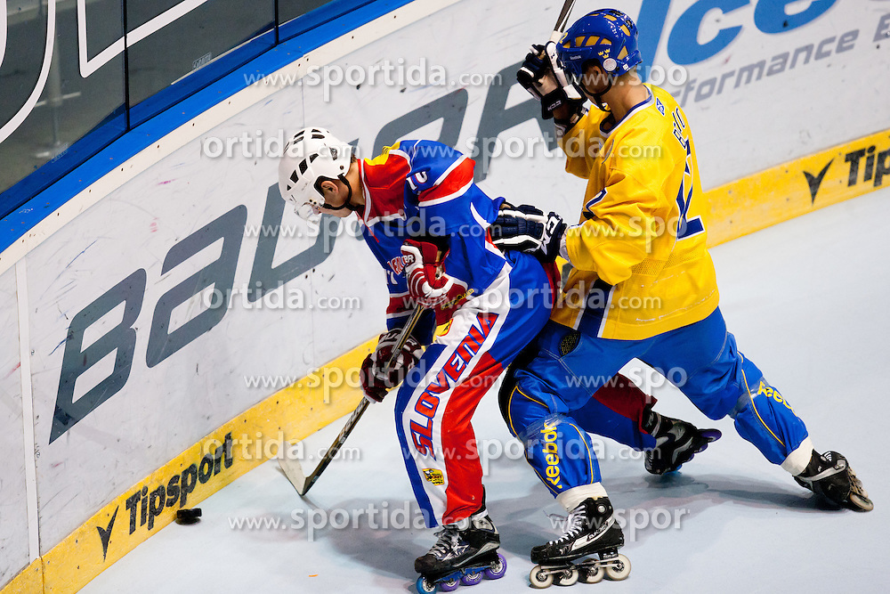 Emil Bejmo of Sweden vs Anze Kuralt of Slovenia at IIHF In-Line Hockey World Championships 2011 Top Division quarter final match between National teams of Slovenia and Sweden on June 23, 2011, in Pardubice, Czech Republic. (Photo by Matic Klansek Velej / Sportida)