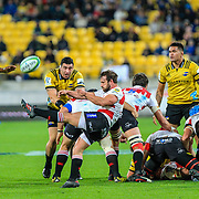 Nic Groom kicks from the ruck  during the Super rugby (Round 12) match played between Hurricanes  v Lions, at Westpac Stadium, Wellington, New Zealand, on 5 May 2018.  Hurricanes won 28-19.