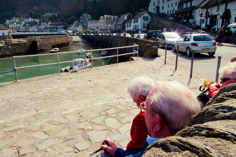 Elderly people enjoying a sunny day at Lynmouth