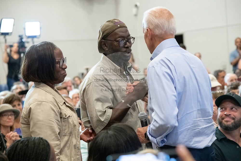 Former Vice President Joe Biden greets Tyrone and Felicia Sanders, during a town hall meeting at the International Longshoreman's Association Hall July 7, 2019 in Charleston, South Carolina.  Felicia Sanders was a surviver of the Emanuel AME Church shooting in 2015 where nine of her fellow worshippers were murdered by a white supremacist.
