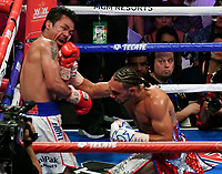 LAS VEGAS, NEVADA - JULY 20. <br /> Manny Pacquiao (R) takes a hit by Keith Thurman during their fight for the WBA welterweight title fight at MGM Grand Garden Arena on July 20, 2019 in Las Vegas, Nevada. Pacquiao went 12 rounds and took the win by a split decision.  (MB Media)
