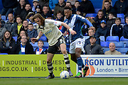 Fulham defender Richard Stearman holds up Birmingham City midfielder Jacques Maghoma during the Sky Bet Championship match between Birmingham City and Fulham at St Andrews, Birmingham, England on 19 March 2016. Photo by Alan Franklin.