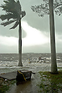 Storm surge from Hurricane Jeanne tops the sea wall along Palma Sola Boulevard in Bradenton, Florida.