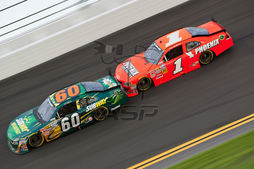Daytona Beach, FL - July 01, 2011: Carl Edwards (60) and Jamie McMurray (1) race off turn four during the Subway Jalapeno 250 at Daytona International Speedway in Daytona Beach, FL.