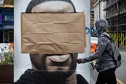"© Licensed to London News Pictures . 22/07/2020 . Manchester , UK . A mural to George Floyd in the Northern Quarter of Manchester City Centre has been covered over after it was sprayed with racist graffiti . It's understood "" Nigger "" was sprayed across the face of the artwork by Manchester artist AKSE overnight . Photo credit : Joel Goodman/LNP"
