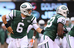 Oct 28, 2012; East Rutherford, NJ, USA; New York Jets quarterback Mark Sanchez (6) hands the ball to New York Jets running back Shonn Greene (23) during the first half of their game against the Miami Dolphins at MetLIfe Stadium.