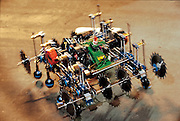 Fearsome sawblades spinning, Pretty Hate Machine menaces the competition at Robot Wars, a two-day festival of mechanical destruction at San Francisco's Fort Mason Center. Organized by Marc Thorpe, a former Industrial Light and Magic model builder, the cybernetic slugfest spawned a six-week BBC-TV series and many similar events. Pretty Hate Machine is a middleweight-class machine; two wheelchair motors power a Rube Goldberg assembly of rods, rubber belts and saw blades. A real crowd-pleaser, Pretty Hate Machine was one of the few walking robots in a competition dominated by wheeled or tracked machines. California. From the book Robo sapiens: Evolution of a New Species, page 200-201.