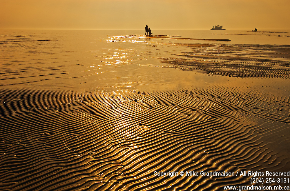 people at the beach at sunset<br />Wahnekewaning Beach<br />Ontario<br />Canada