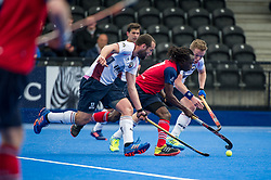 Hampstead & Westminster's Kwan Browne is challenged by Ian Sloan and Phil Ball of Wimbledon. Wimbledon v Hampstead & Westminster - Semi-Final - Men's Hockey League Finals, Lee Valley Hockey & Tennis Centre, London, UK on 22 April 2017. Photo: Simon Parker