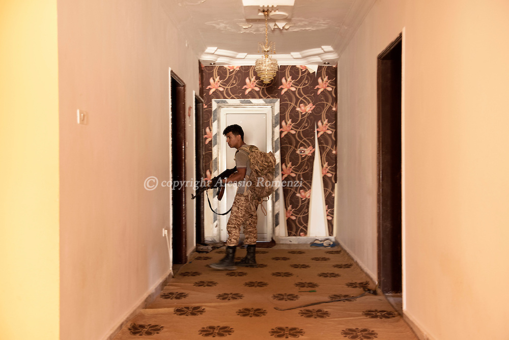 Libya: Libya's Government of National Accord's (GNA) fighter inspects a house in 700 neighbourhood in Sirte still under ISIS control. Alessio Romenzi