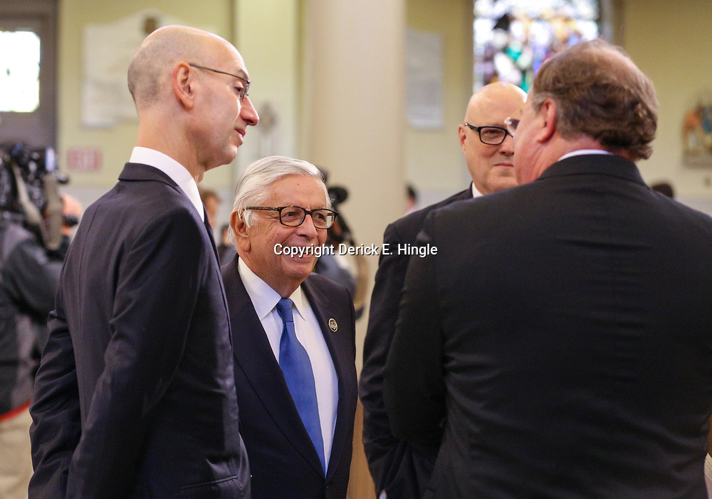 NBA Commissioner Adam Silver and former NBA Commissioner David Stern talk with New Orleans Saints President Dennis Laucsha at the funeral service for NFL New Orleans Saints owner and NBA New Orleans Pelicans owner Tom Benson in New Orleans, Friday, March 23, 2018. Benson died last Thursday at the age of 90. (AP Photo/Derick Hingle)