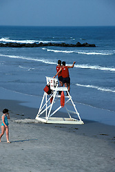 Life guard, shore patrol member checks bathers in surf on the beach in Stone Harbor, NJ.