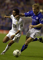 Photo: Greig Cowie.<br /> 15/09/2003.<br /> Barclaycard Premiership. Leicester City v Leeds United, The Walkers Stadium.<br /> Jermaine Pennant takes on Ben Thatcher