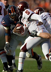 Virginia Tech quarterback Tyrod Taylor (5) is pressured by Virginia defensive end Jeffrey Fitzgerald (95).  David Becker and other UVA students camped outside the student entrance to Scott Stadium on the evening before the annual Virginia and Virginia Tech Football Game.