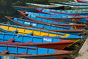 Colorful blue boats on Phewa Lake (or Fewa Tal), in Pokhara, Nepal.
