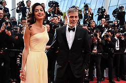 Hollywood star George Clooney was treated in hospital on Tuesday for minor injuries after a scooter accident in Sardinia, Italy on July 10, 2018 ------------ George Clooney and his wife Amal Clooney attending the Money Monster screeningat the Palais Des Festivals in Cannes, France on May 12, 2016, as part of the 69th Cannes Film Festival. Photo by Lionel Hahn/ABACAPRESS.COM