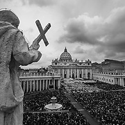 Pilgrims gather in St. Peter's Square during the historical canonization of Jonh Paul II and John XXIII.The double canonisation of two of modern-day Catholicism's most influential figures was presided over by Pope Francis and was attended by his elderly predecessor Benedict XVI, bringing two living pontiffs together to celebrate two deceased predecessors.