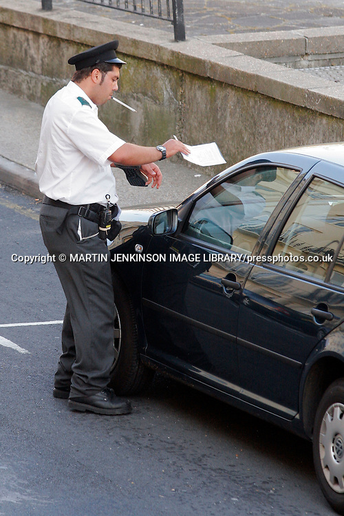 Traffic Warden issuing of a parking ticket in Brighton ......