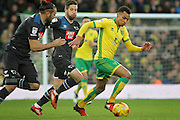 Norwich City midfielder Jacob Murphy runs away from the derby defence during  the EFL Sky Bet Championship match between Norwich City and Derby County at Carrow Road, Norwich, England on 2 January 2017. Photo by Nigel Cole.