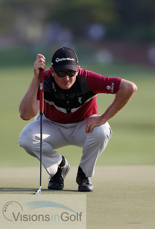 Justin Rose with his putter<br /> during the second round of the Race To Dubai DP World Tour Golf Championship, Dubai, UAE November  2013<br /> Picture Credit:  Mark Newcombe / www.visionsingolf.com