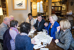 © Licensed to London News Pictures . 13/01/2015 . Stockport , UK . Deputy Prime Minister Nick Clegg (3rd from right) meets with members of High Lane Residents' Association and Lib Dem PPC for Hazel Grove , Lisa Smart (2nd from right) , at the Red Lion Inn , High Lane , Hazel Grove . Photo credit : Joel Goodman/LNP