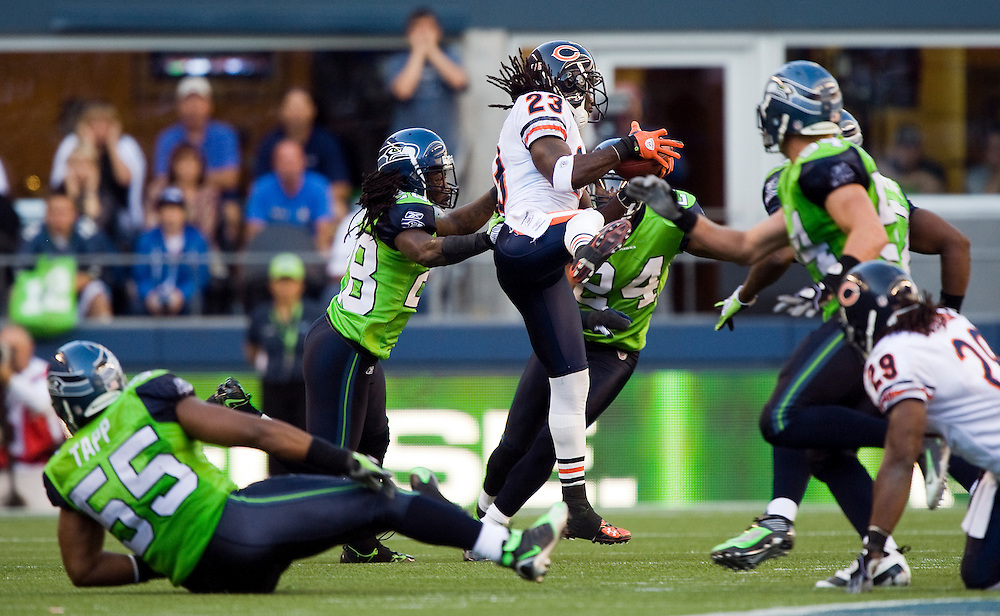 SEATTLE SEAHAWKS VS CHICAGO BEARS - Chicago's Devin Hester catches a slant route in the midst of five Seattle defenders, then escaped them all for a touchdown reception of 36 yards that gave the Bears a 25-19 victory.