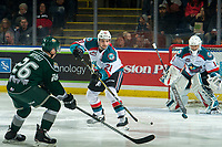KELOWNA, CANADA - JANUARY 9:  Schael Higson #21 of the Kelowna Rockets passes the puck away from Reece Vitelli #26 of the Everett Silvertips during first period on January 9, 2019 at Prospera Place in Kelowna, British Columbia, Canada.  (Photo by Marissa Baecker/Shoot the Breeze)